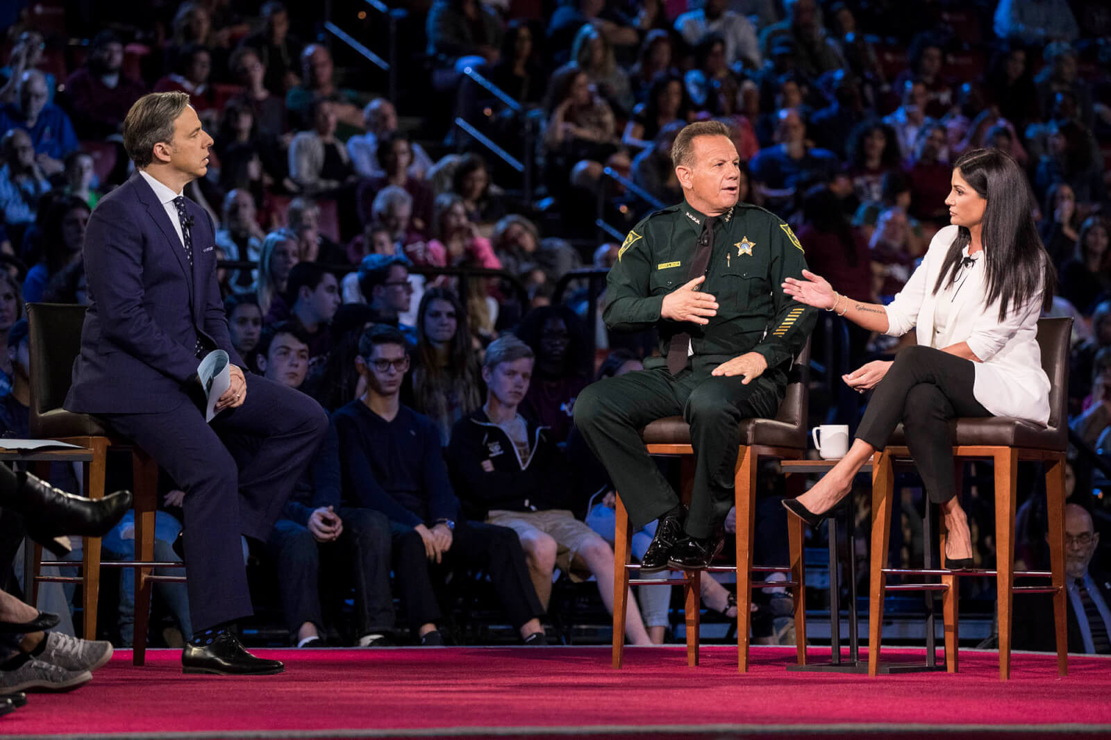 CNN anchor Jake Tapper, Broward County Sheriff Scott Israel and NRA spokesperson Dana Loesch at the CNN Town Hall at the BB&T Center