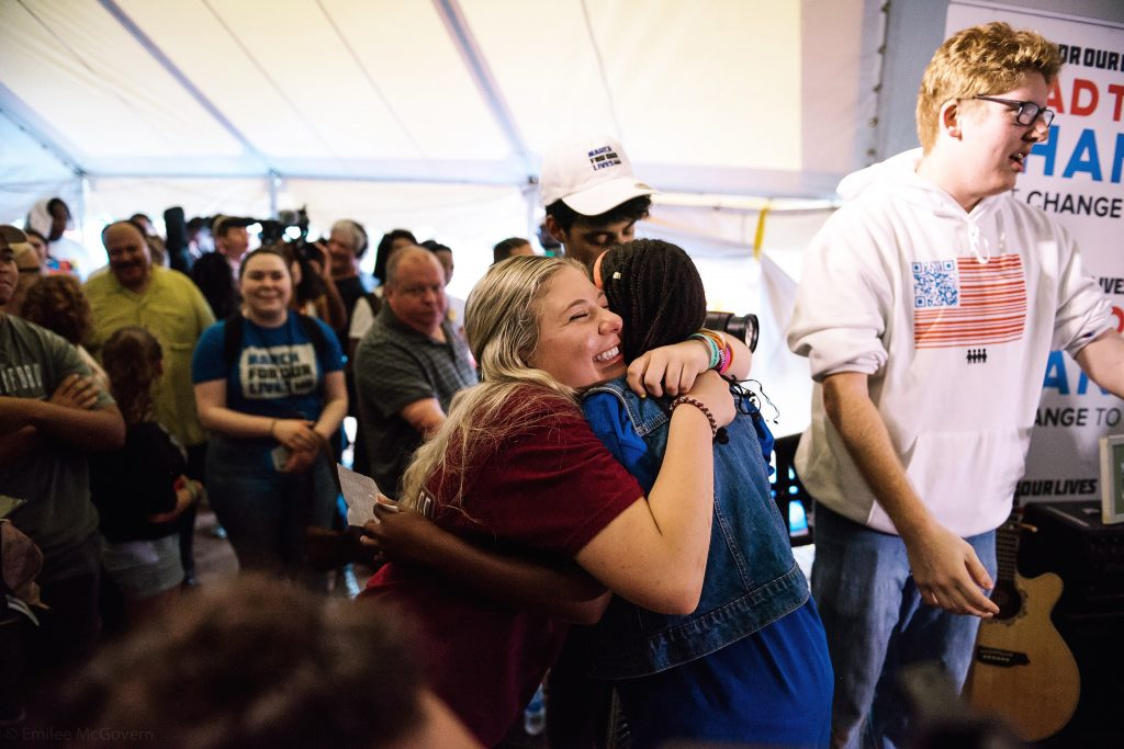 Corin shares an emotional embrace during a Road to Change event in Newtown, Connecticut—where the Sandy Hook shooting took place in 2012.