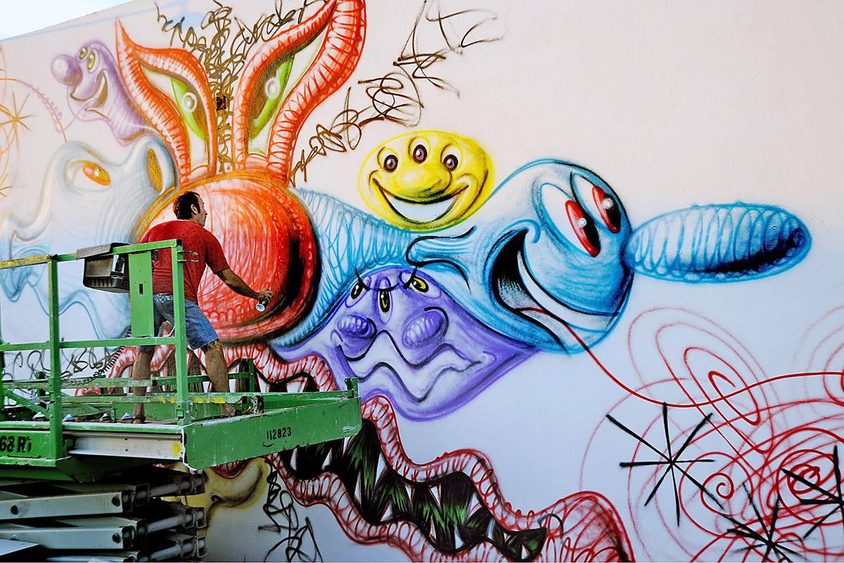 Artist Kenny Scharf creating a piece at Wynwood Walls in 2009