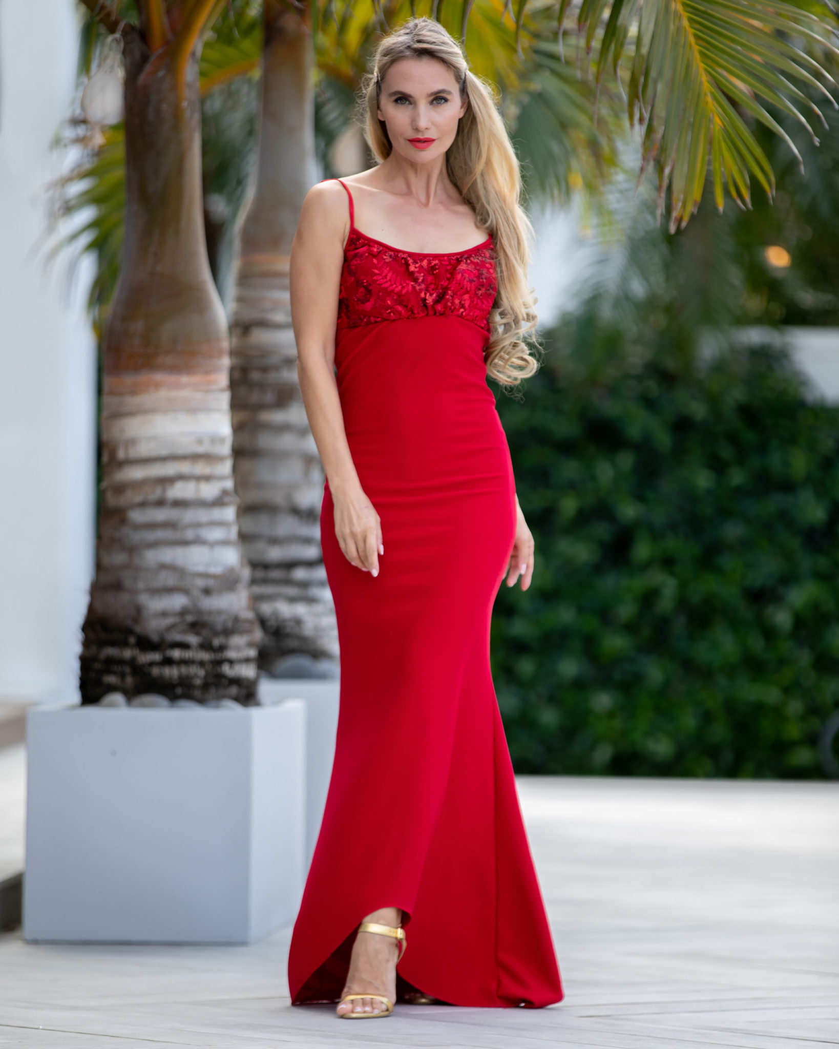 Red hot: A semi high-low dress, with a deep cut in the back, this classic piece in semi-stretch material oozes glamour while providing comfort; the front cut is made with beaded Chantilly fabric flower details. (Model: Victoria Liub)