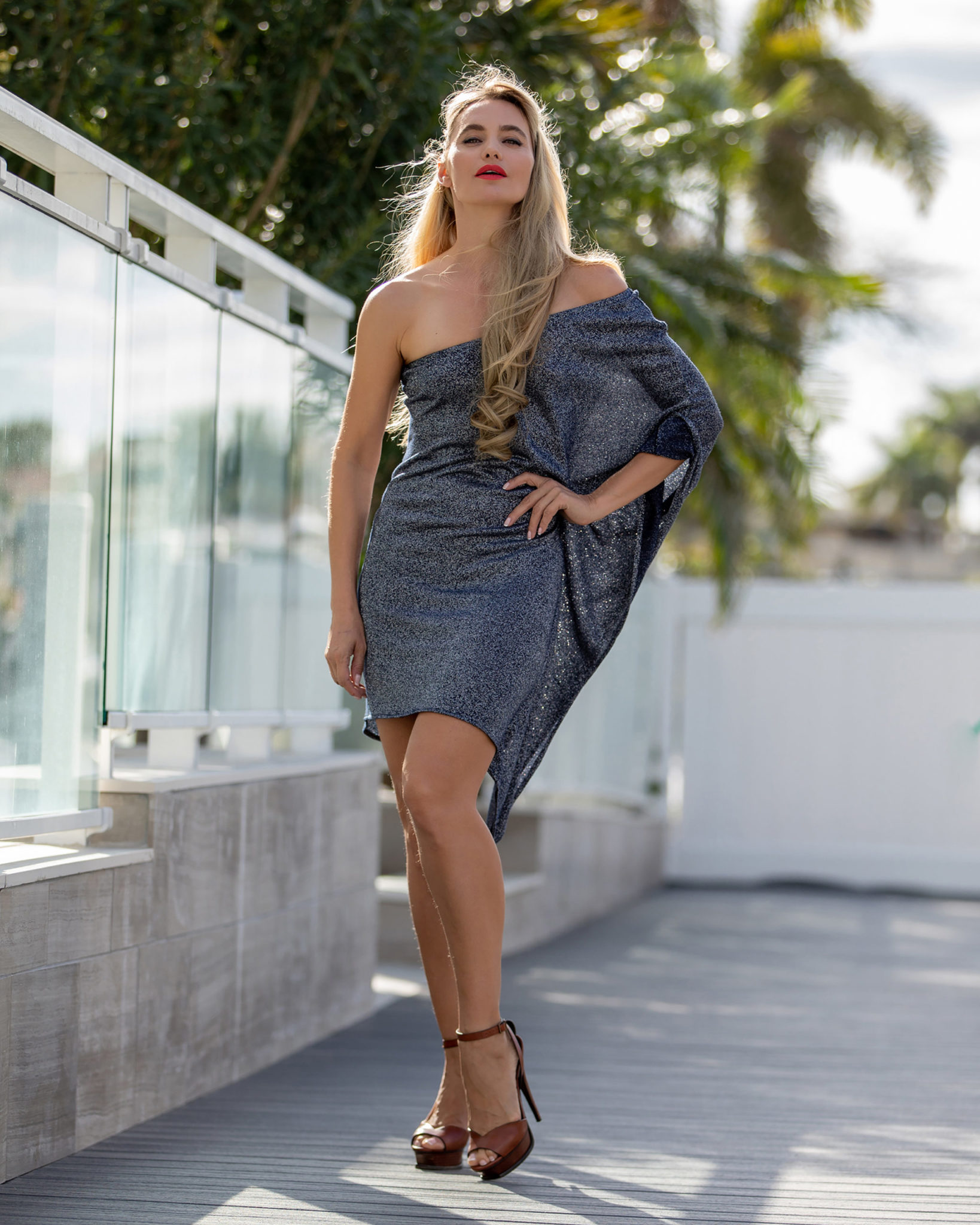 Silver and spice: This sexy, asymmetric, one-shoulder short dress—designed with stretch acrylic and semi-synthetic viscose material—incorporates illusion threads that add stylish detail to the look. (Model: Victoria Liub)